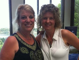 Alisen Dopf standing with Suze Casey at a course.