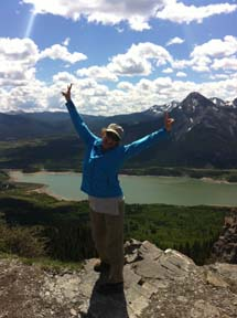 Sue on top of the mountain, loving life after a very steep hike.
